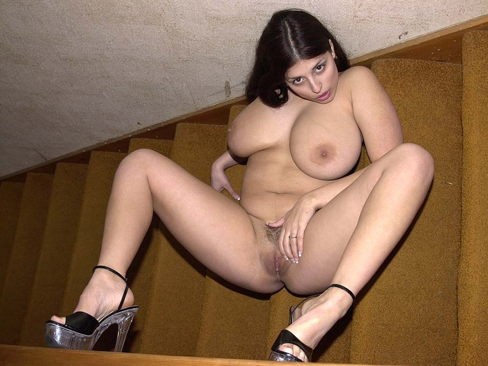 Busty latina fingering pussy on the stairs